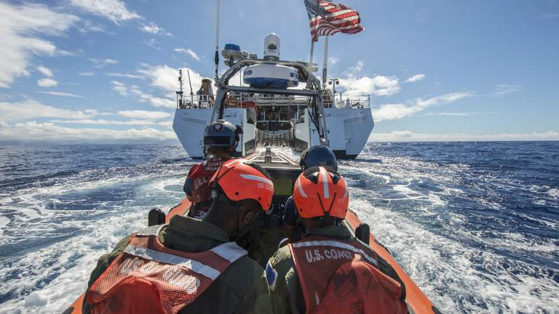 Coast Guard Cutter Stratton's crew members aboard a small boat return to the Stratton after a humanitarian assistance/disaster relief event for Rim of Pacific Exercise 2016, the world's largest international maritime exercise, in the Pacific Ocean.