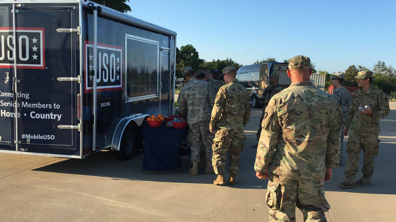The Mobile USO program team hands out snacks and cold beverages to service members at Fort Swift, the staging location for much of the military's Harvey relief efforts.