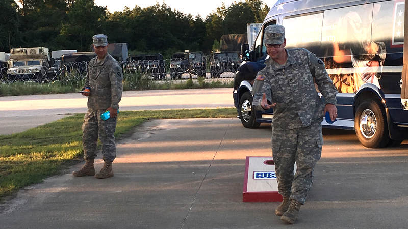 Service members play corn hole provided by the Mobile USO team at Fort Swift, the staging location for much of the military's Harvey relief efforts.