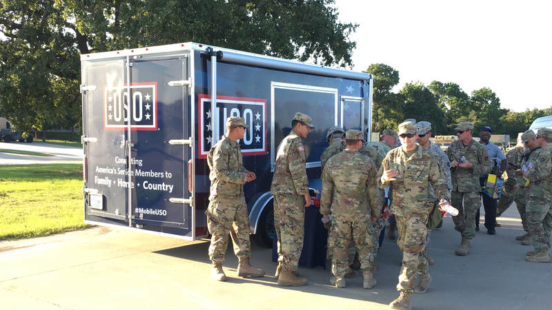 The Mobile USO team hands out snacks and cold beverages to service members at Fort Swift, the staging location for much of the military's Harvey relief efforts.