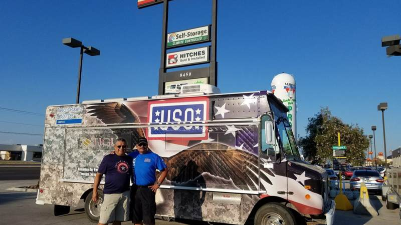 Volunteers smile in front of the USO El Paso Mobile unit, which will head to the Houston area to provide refreshments to service members supporting Harvey relief efforts.