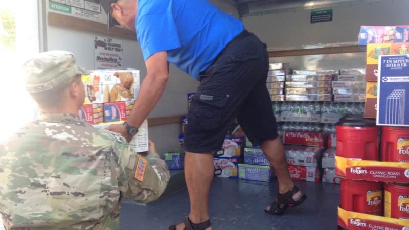 Volunteers stock the USO El Paso Mobile unit, which will head to the Houston area to provide refreshments to service members supporting Harvey relief efforts.