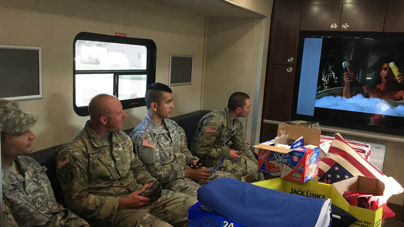 Service members sit inside the USO Mobile unit at Fort Swift, the staging location for much of the military's Harvey relief efforts.
