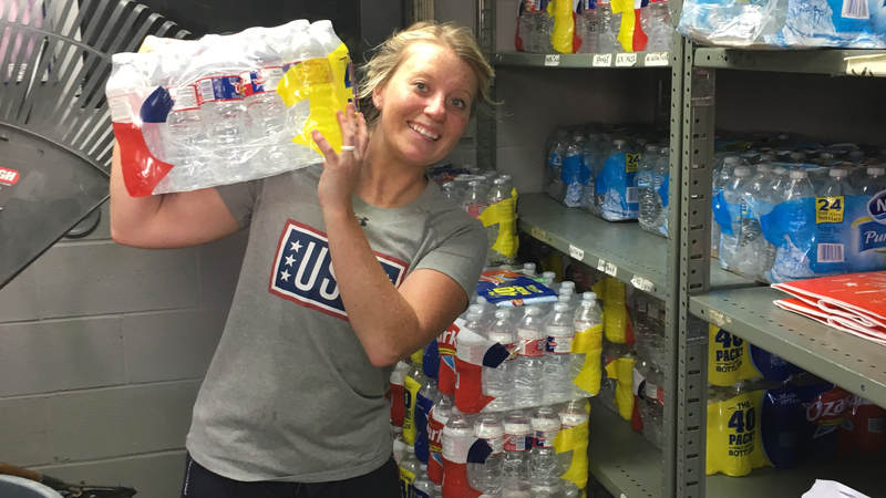 The USO Mobile staff loads up the mobile units with water.