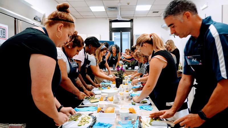 "Carla Hall, celebrity chef and co-host of ABC's ""The Chew,"" went on a recent five-day USO tour to Italy and Spain to cook and connect with service members and their families."
