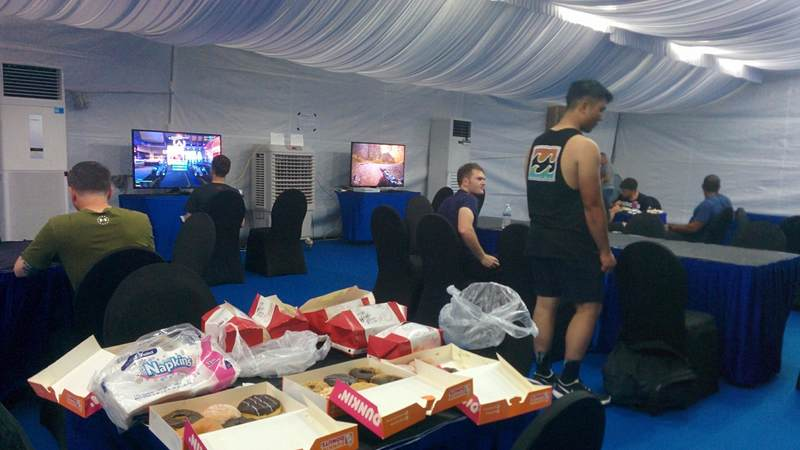 Sailors from the USS McCain enjoy video games, air conditioning and even Dunkin' Donuts thousands of miles from their home port, courtesy of the USO.