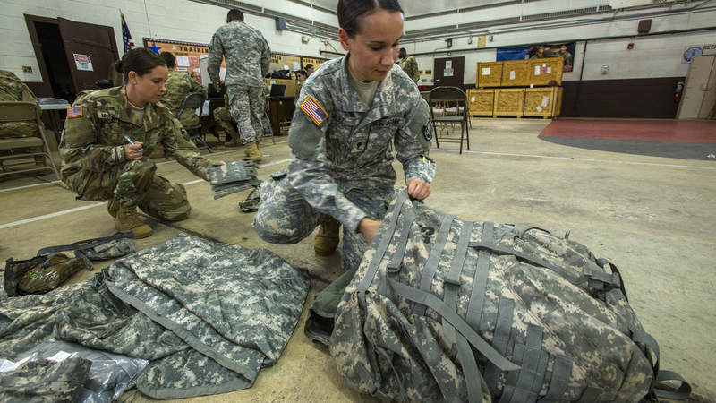 Army Spc. Sheila Velez packs as more than 130 New Jersey Army National Guard soldiers prepare to deploy to support the Florida National Guard in anticipation of Hurricane Irma.