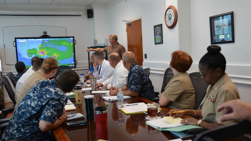 Kevin Robarge, head of operations at U.S. Naval Hospital Guantanamo Bay, provides information to leadership concerning Hurricane Irma.