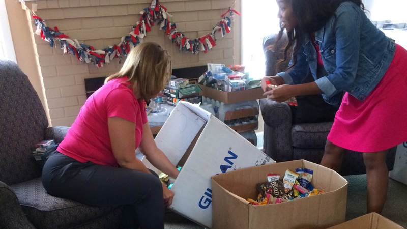 The Greater Jacksonville Florida Area USO team preps care package supplies to hand out to service members supporting Hurricane Irma relief efforts.