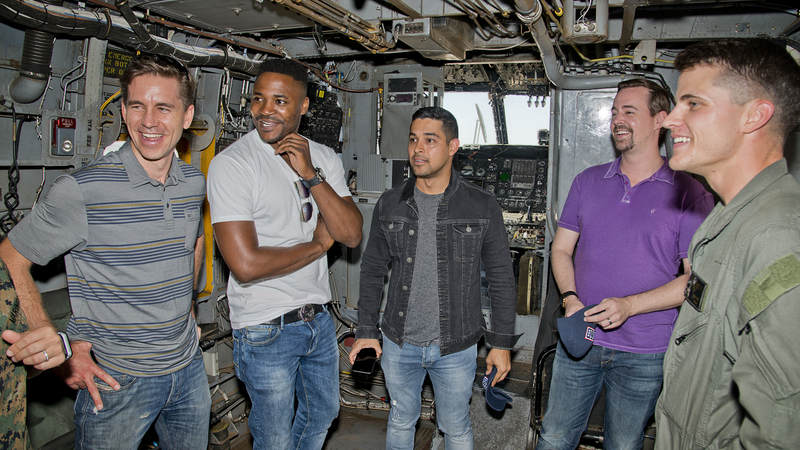 From left to right, Brian Dietzen, Duane Henry, Wilmer Valderrama, and Sean Murray get an up-close look inside a Marine CH-53 Sea Stallion at Marine Corps Air Station Miramar, California.