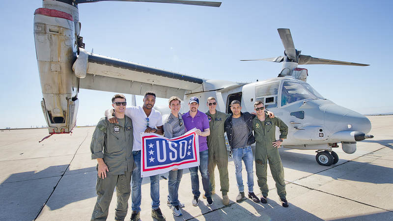 'NCIS' stars pose in front of an MV-22 Osprey helicopter at Marine Corps Air Station Miramar during a USO tour in September.