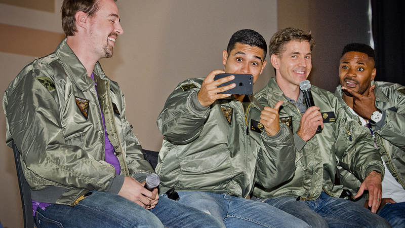 Sporting their new gifted flight jackets during a Q&A session on stage - Sean Murray, Wilmer Valderrama, Brian Dietzen and Duane Henry take a selfie in response to questions from the audience.