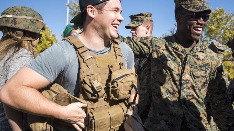Comedian and actor Adam Devine meets with Marines assigned to Special Purpose Marine Air-Ground Task Force – Crisis Response – Africa as part of a troop engagement during the Chairman's USO Holiday Tour at Morón Air Base Dec. 21.