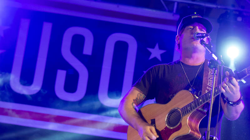 Country music artist Jerrod Niemann performs during Chairman's USO Holiday Tour at Morón Air Base, Spain, Dec. 21.