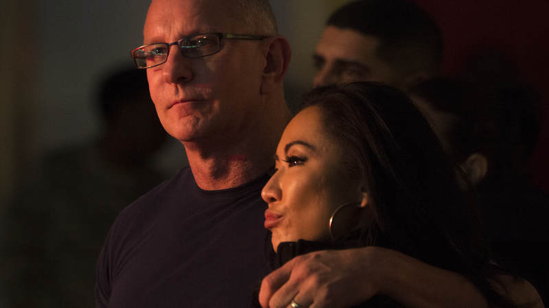 Chef Robert Irvine and his wife, Gail Kim, watch country music artist Jerrod Niemann perform during Chairman's USO Holiday Tour at Morón Air Base Dec. 21.