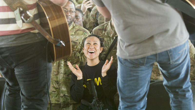 Country music artist Jerrod Niemann performs for service members during the USO Holiday Tour at Taji Military Complex, Iraq, Dec. 25.