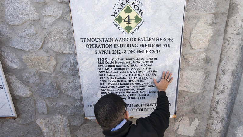 Medal of Honor recipient, retired Army Capt. Florent Groberg pays tribute to those who were killed in action at a memorial while visiting Operating Base Fenty, Afghanistan.