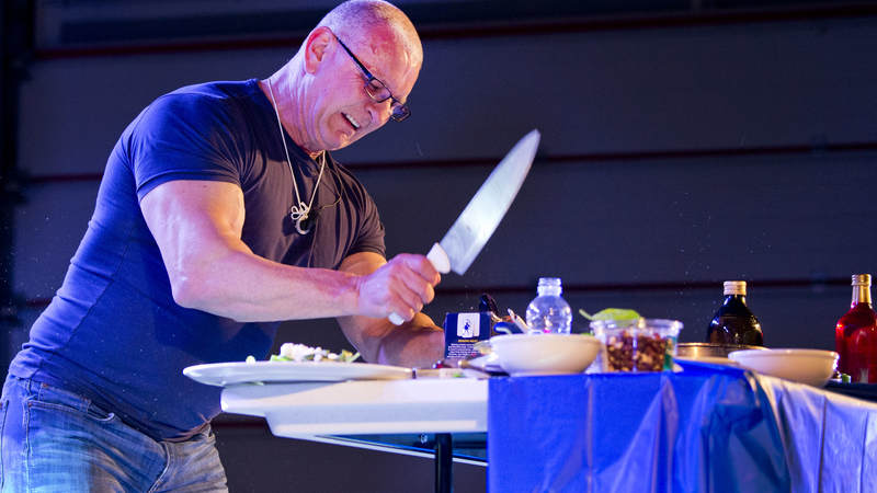 Chef and TV host Robert Irvine hosts a cooking demonstration during during the USO Holiday Tour at Al Dhafra Air Base.