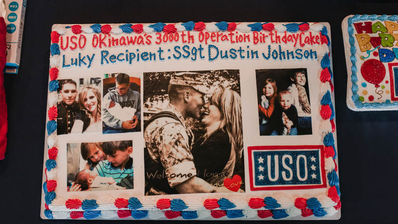 Marine Staff Sgt. Dustin Johnson's birthday cake was one-of-a-kind, thanks to his wife, Melanie, who supplied the photos. USO photo by Amber Craig.