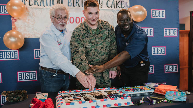 Marine Staff Sgt. Dustin Johnson, who's deployed to Okinawa, Japan, turned 29 earlier this week. He thought he was invited to lunch at USO Camp Hansen and had no idea he was showing up to his own birthday party. USO photo by Amber Craig.