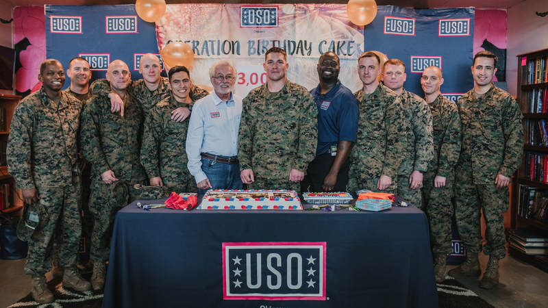 Marine Staff Sgt. Dustin Johnson, center, who's deployed to Okinawa, Japan, turned 29 earlier this week. He thought he was invited to lunch at USO Camp Hansen and had no idea he was showing up to his own birthday party. He celebrated with his fellow Marines and USO staff. USO photo by Amber Craig