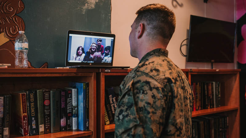 Marine Staff Sgt. Dustin Johnson, who's deployed to Okinawa, Japan, talks to his family in North Carolina over Skype during his surprise birthday celebration. USO photo by Amber Craig.