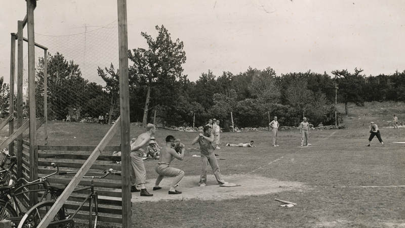 Service members play baseball in Flatts Village, Bermuda, in the 1940s