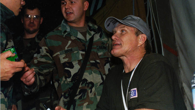 Pittsburgh Steelers football great Terry Bradshaw talks with troops during his visit to Tuzla Air Base, Bosnia, in 2000.