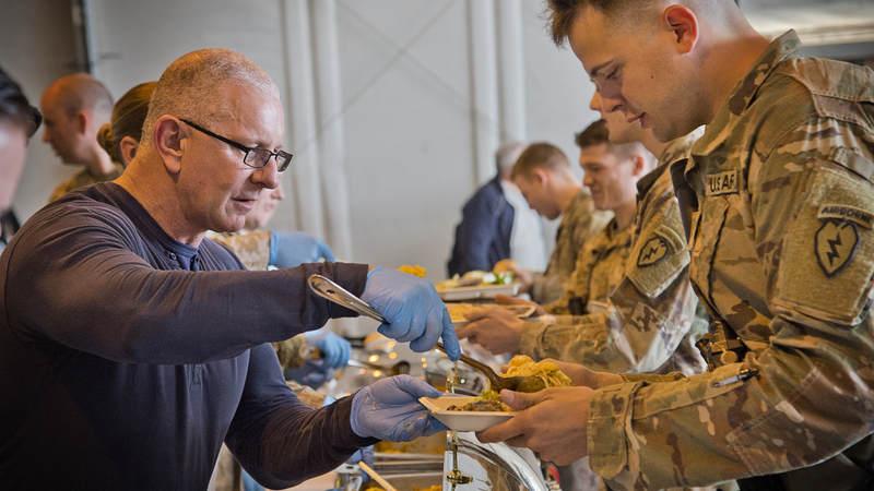 Irvine serves a meal to troops in Bagram.