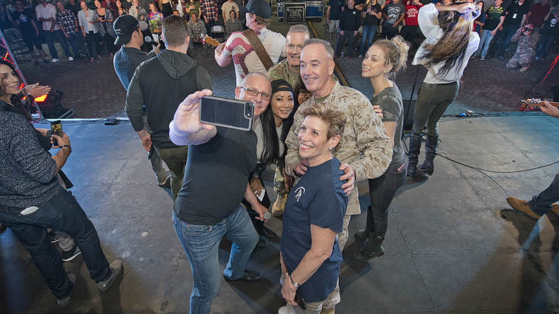 Irvine and wife, Gail Kim, pose for a selfie with General Dunford and others during their visit to Al Dhafra Air Base.