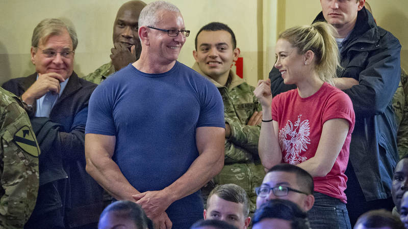 Irvine and comedian, Iliza Shlesinger, are all smiles during their holiday USO tour.