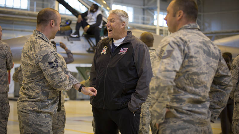 Former NFL head coach Rex Ryan has a laugh during the 2018 USO-NFL tour.