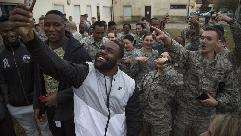 New Orleans saints running back Mark Ingram takes a selfie with troops at Aviano Air Base in Italy during the 2018 USO-NFL tour.