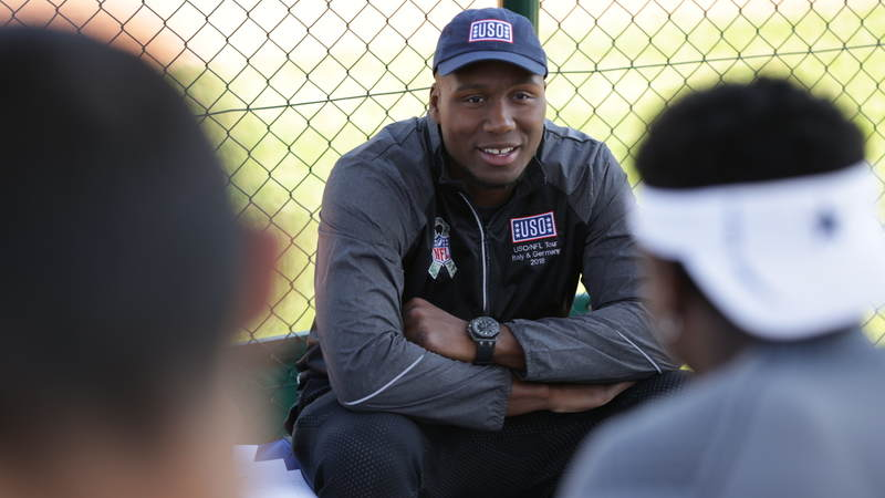 Cincinnati Bengals defensive end Carlos Dunlap listens during a question-and-answer session with high school football players in Germany.