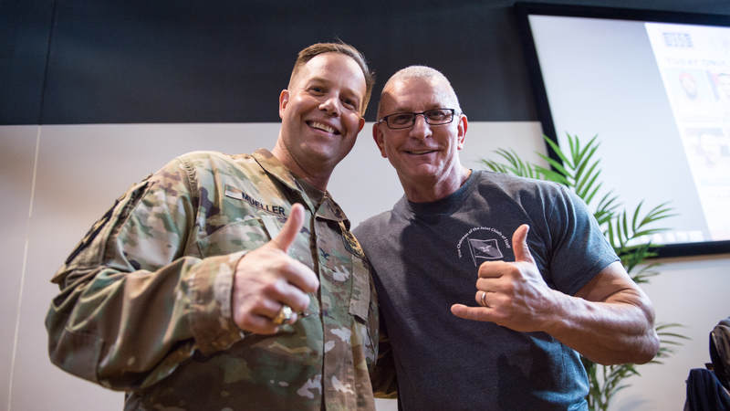 Celebrity chef and TV host Robert Irvine poses for a photo with a service member. Army photo by Sgt. James McCann