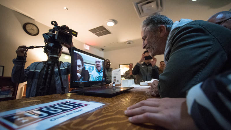 "Former ""Daily Show"" host Jon Stewart talks to parents of a service member during an Operation Birthday Cake at a USO center in South Korea. Army photo by Sgt. James McCann"