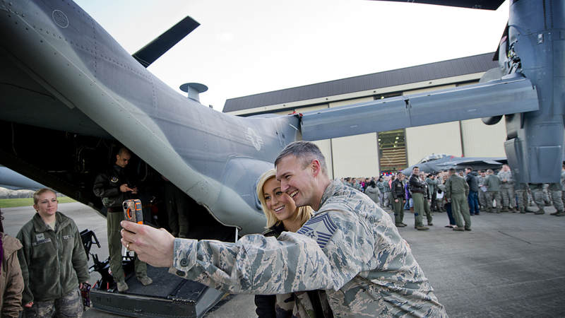 Pickler poses for a quick selfie taken by Air Force Command Master Sgt. Thomas in front of a CV-22 at RAF Mendenhall in the U.K.