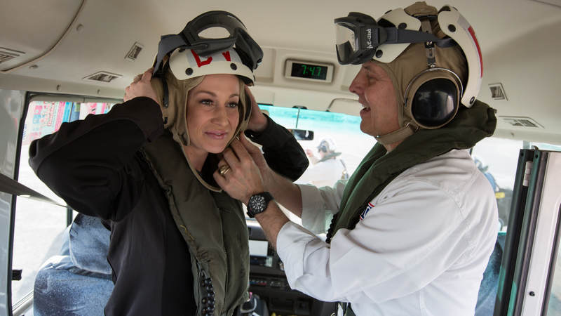 """Pickler """"suits up"""" during a 2012 USO holiday tour stop in Bahrain."""
