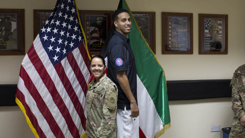 Kevin Martin poses with a service member.
