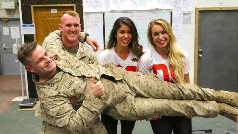 Cheeleaders Brianna Stade, right, and Alexandria Giannini have some fun with service members during their USO tour to Iraq and Kuwait.