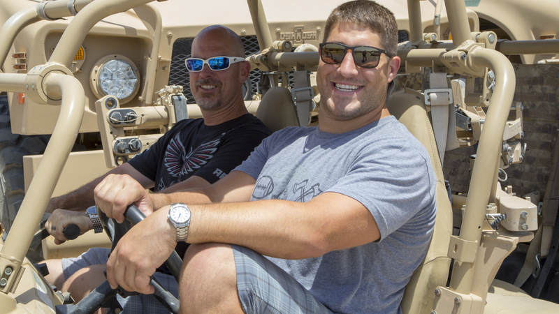 Falcons players Matt Bryant, left, and Alex Mack are ready to go off-roading in a military vehicle during their USO tour to Iraq and Kuwait.