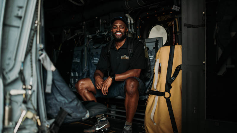 Former New York Giants wide receiver Amani Toomer takes a seat inside a military aircraft during the USO-NFL Legends tour of Okinawa, Japan, on July 25-26. USO photos by Amber Craig