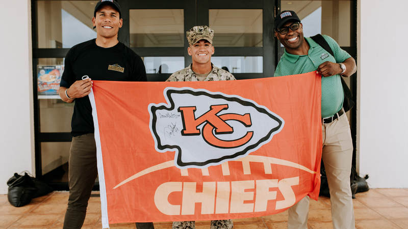 Donnie Edwards, left, and Tony Richardson both played for the Kansas City Chiefs during their NFL careers and they met one of their biggest fans during the USO-NFL Legends tour to Okinawa, Japan, on July 25-26. USO photos by Amber Craig