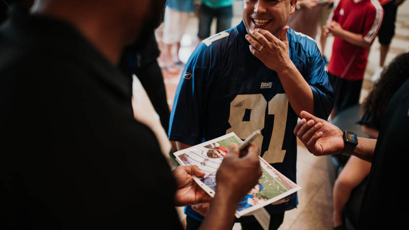Amani Toomer signs an autograph for one of his biggest fans during the USO-NFL Legends tour to Okinawa, Japan, on July 25-26. USO photos by Amber Craig