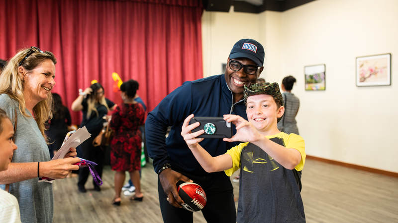 Former NFL star Tony Richardson, who played most of his 16-year NFL career with the Kansas City Chiefs, poses for a photo with a young fan during the USO-NFL Legends tour to Okinawa, Japan, on July 25-26. USO photos by Amber Craig