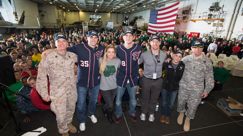 Members of the 2012 USO Holiday Tour, Craig Stammen, Kellie Pickler, Ross Detwiler, Matt Hendricks and Iliza Shlesinger, pose for a quick photo onboard the USS John C. Stennis.