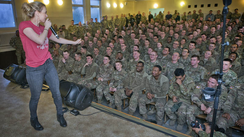 Iliza Shlesinger performs for troops in Poznan, Poland during the 2017 USO Holiday Tour.