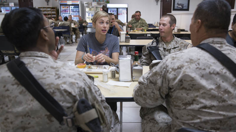 Iliza Schlesinger shares a meal with service members in Afghanistan during the 2014 TODAY USO Comedy Tour.