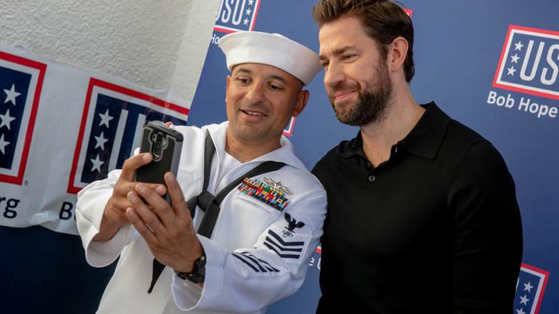 """Jack Ryan"" star John Krasinski snaps a photo with a sailor during a USO tour during Los Angeles Fleet Week August 31."