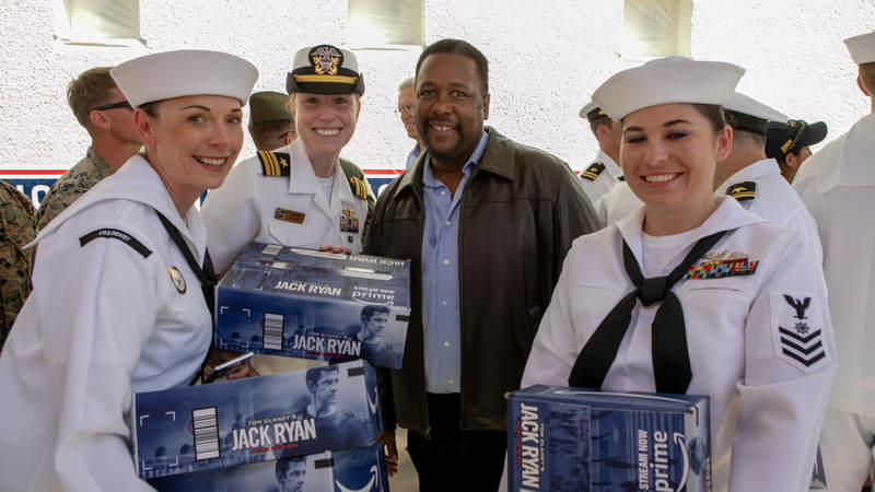 """Actor Wendell Pierce, who stars in the new Amazon Prime series, """"Tom Clancy's Jack Ryan,"""" poses with sailors during a USO tour during Los Angeles Fleet Week on August 31."""